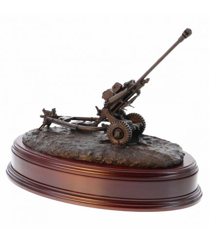 Our newly updated modern British Army Royal Artillery 105mm Light Gun in cold cast bronze resin. The sculpture is mounted on a wooden base which is designed to take a cap badge and engraved plate. It makes an ideal military farewell gift or commemorative