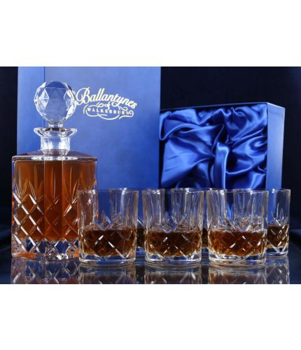 A fully cut  whisky crystal hosting set consisting of a Decanter and six tumblers. The set is completed inside two dark blue satin lined presentation boxes.
