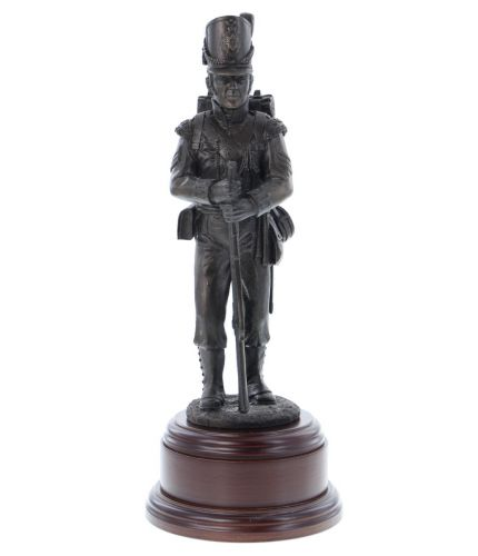 Bronze resin statue of a guardsman of the Grenadier Guards dressed in parade dress with bearskin and SA80