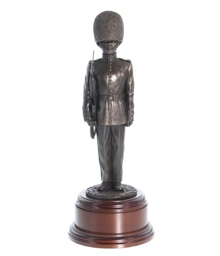 Bronze cold cast resin statuette of a Guardsman of The Scots Guards dressed in full parade dress with the distinctive red tunic and bearskin hat. He is armed the SLR rifle.