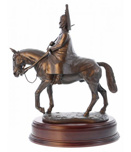 This is a cold cast bronze resin statue of a Blues and Royals Trooper mounted on horse back and dressed in Winter Review Order. We offer a range of wooden bases and engraved plates