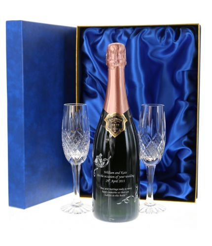 This engraved Rose Bollinger set consists of a 75cl Bottle of Champagne and two fully cut crystal champagne flutes. The set are beautifully presented in a lovely dark blue satin lined presentation box. An Ideal gift for a romantic occasion.