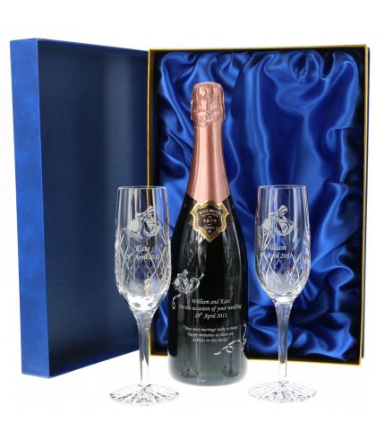 This engraved Rose Bollinger set consists of a 75cl Bottle of Champagne and two panel crystal champagne flutes. The set are beautifully presented in a lovely dark blue satin lined presentation box. An Ideal gift for a romantic occasion.
