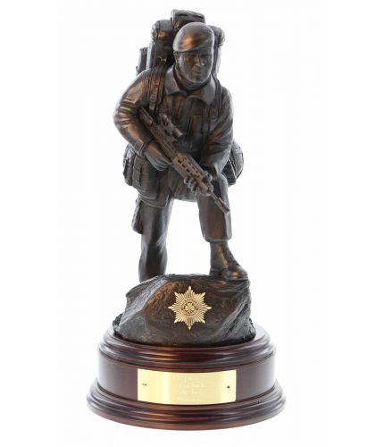 "British Army Soldier in an alert pose. Sculpted at the 11"" Scale he is equipped with an SA80 rifle, webbing and bergan.  This piece makes a wonderful leaving or military retirement gift. Included is an optional regimental crest in the base and a personali"