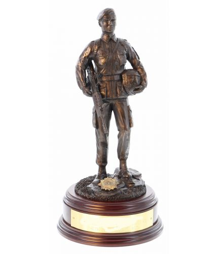 This is a sculpture of a female British Army Soldier in battledress wearing PLCE webbing, carrying her SA80 Rifle and helmet.