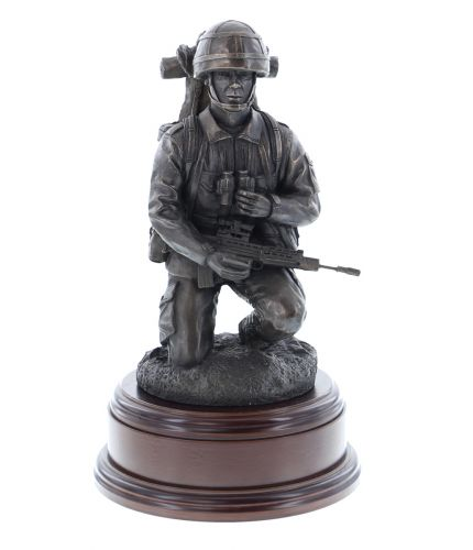 A bronze sculpture of a Junior Section or Fire Team Commander on foot patrol. He's crouching down to read his map and is equipped for a long duration patrol. Wooden base and brass engraved plate are included.