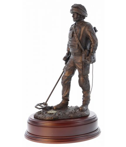 Sculpture depicts a British Army Soldier sweeping for Explosive Ordnance Devices with a Vallon Mine Detector. We include this wooden base as standard, and you can also add a badge and engraving plate free of charge.