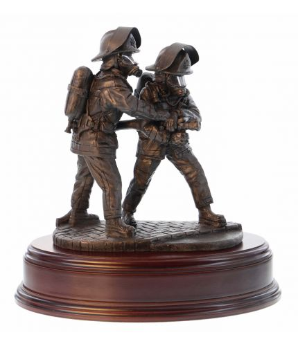 This Fire and Rescue statuette is made in an eight inch scale and it is called 'The Branch'. It depicts a pair of firefighters directing a high pressure jet of water at the seat of a blaze. Our Bronze fire service sculptures make first class retirement, l
