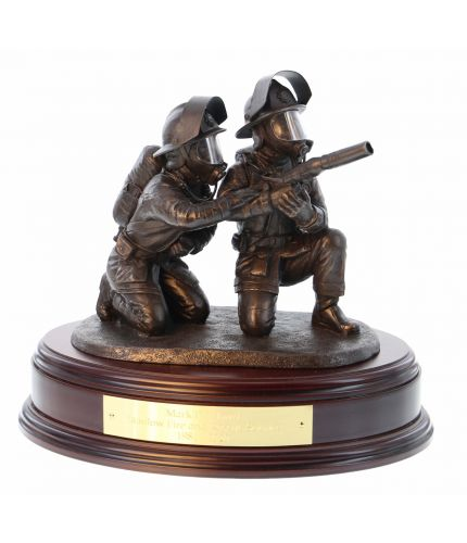 This Fire and Rescue statuette is made in an eight inch scale and it is called 'Laying Foam'. It depicts a pair of firefighters directing a high pressure jet of foam at the seat of a blaze. Our Bronze fire service sculptures make first class retirement, l