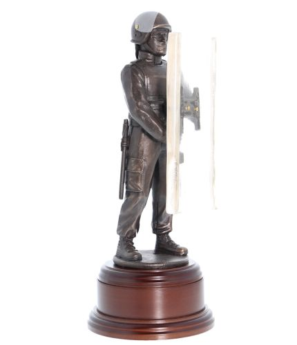 Bronze British Police Constable from one of the British Mainland Police forces dressed and equipped for 'crowd control', or 'riot' duties. We include the standard wooden base and an engraved brass plate as standard.
