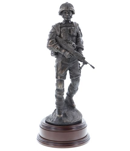 "Knackered RAF Regiment Soldier in the 12"" Scale. He has an RAF badge in his beret and a RAF Regiment crest in the base."