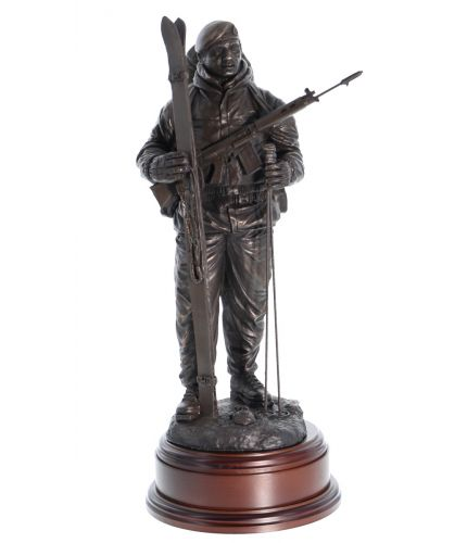 "12"" scale cold cast bronze resin sculpture of a Royal Marine Commando dressed for arctic warfare with Skis and poles. His SLR Rifle is slung across his chest."