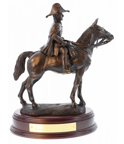 This is our Duke of Wellington statuette. He's mounted on Copenhagen during the Battle of Waterloo and it is made in the 8 inch scale, (overall height 14 inches). We include the standard wooden base and an engraved brass plate.