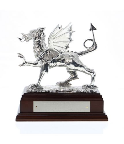 Welsh Dragon in polished lead free pewter. A Classic Welsh Dragon, perfect for a Welsh farewell or retirement. It's hand made here in our factory and we offer it on a choice of wooden bases. The engraving plate is provided free of charge.