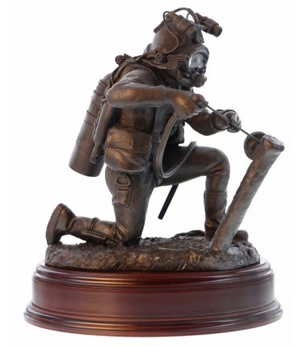 Cold Cast Bronze presentation sculpture depicting an Industrial or Military Diver on Seabed. We offer it with the wooden base of your choice and an optional brass engraved plate.