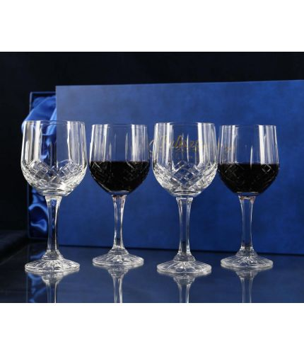 A Set of Four Fully Cut Crystal Red Wine Glasses presented in a lovely satin lined dark blue gift box. An ideal gift to commemorate a very special occasion. No engraving is possible on fully cut crystal.