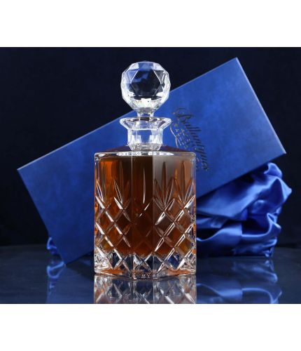 A fully cut 24% Lead Crystal Whisky Decanter. The set is completed inside a dark blue satin lined presentation box.