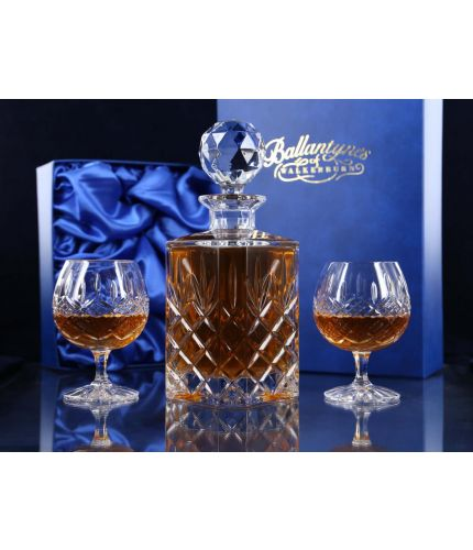 Brandy Decanter and two goblets mounted into a blue satin lined presentation box. This is the Fully cut style and therefore no engraving is possible. The fully cut crystal offer a very classic timeless style.