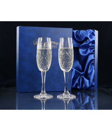 A Pair of Fully Cut Crystal Champagne Flutes presented in a lovely satin lined dark blue gift box. An ideal gift to commemorate a very special occasion. No engraving is possible on fully cut crystal.