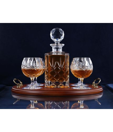 Cut crystal cognac tray set with a decanter and four goblets on a brass handled tray. The set comes in luxurious gift boxes and can include an engraved brass plate on the tray.