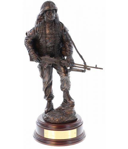 "12"" scale cold cast bronze resin sculpture of a British Army Soldier carrying a GPMG on patrol. We include the wooden base and engraved brass plate."