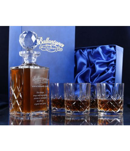 A mixed style of whisky crystal hosting set consisting of a Decanter and four tumblers. We offer free engraving in the front panel of the decanter. The set is completed inside a dark blue satin lined presentation box.