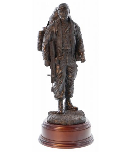 This is a modern British Army, he's 'The Knackered Tom'. We've made sure he's dressed in modern combat fatigues and is carrying his usual load of equipment and a belt of ammo for a GPMG. We include this wooden base as standard, and you can also add a bad