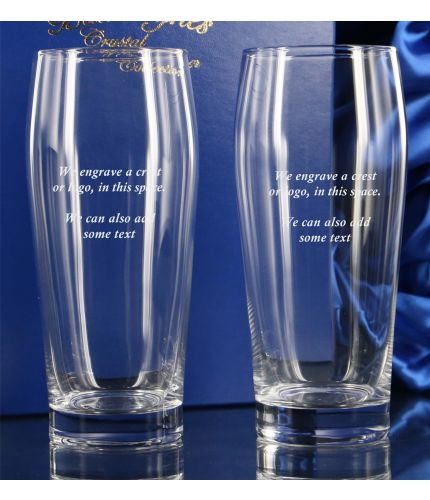 A pair of engraved Lager Glasses in a hand crafted satin lined blue presentation box. The price includes all engraving with text and images of your choice.