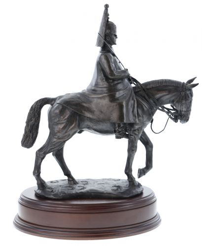 This statuette depicts a mounted trooper of The Life Guards in winter dress undertaking ceremonial duties outside the Horse Guards buildings in Whitehall.