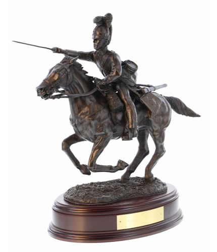 Charge of the Royal Scots Greys during the Battle of Waterloo in 1815. This is our 14 inch tall cold cast bronze display sculpture which is perfect on a sideboard, mantlepiece or dining table. We include the wooden base and an engraved plate with your ord