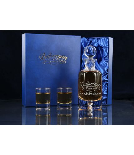 A Nightcap Set consisting of two mini dram glasses and a one third size glass decanter. We offer free engraving in the front panels of each piece of glass and the set is completed inside a dark blue satin lined presentation box.