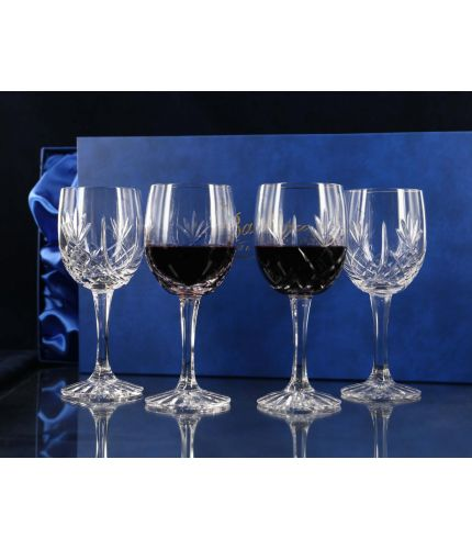 Four panel cut red wine goblets in a presentation box. We offer free engraving in the front panels of each item and the set is completed inside a dark blue satin lined presentation box.