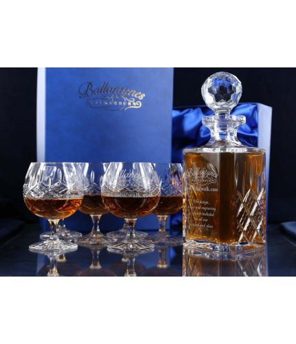 A Panel cut set of brandy hosting crystal consisting of a decanter and six goblets. We offer free engraving in the front panels of each item and the set is completed inside two dark blue satin lined presentation boxes.