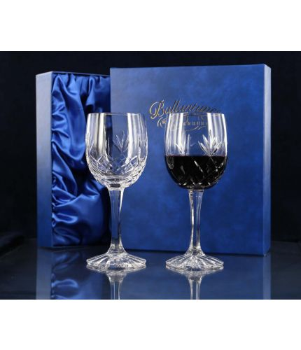 A pair of panel cut red wine goblets. We offer free engraving in the front panels of each item and the set is completed inside a dark blue satin lined presentation box.