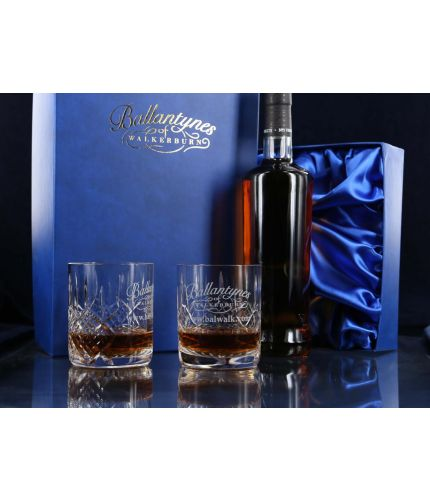 A Panel Cut set of a pair of crystal whisky tumblers in a presentation box with the space to take a 70cl bottle of Whisky. The set is completed inside a dark blue satin lined presentation box. (The Bottle of Whisky is a separate purchase)