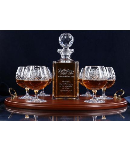 A 24% lead crystal panel cut square decanter and six panel cut brandy goblets on a serving tray. We can offer a personalised engraving on the front of the decanter, goblets and an engraved brass plate on the wooden tray with this set.