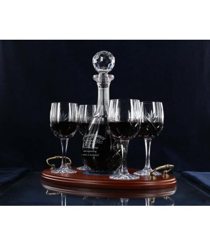 A 5 piece, panel cut, wine tray set consisting of a decanter and four panel cut red wine goblets with a wooden serving tray. We offer free engraving in the front panels of each item and the set is completed inside a dark blue satin lined presentation box.