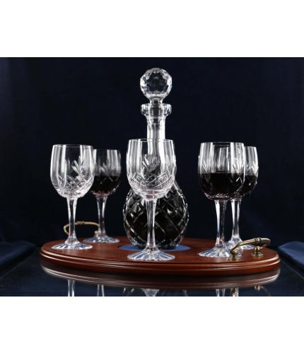 A 7 piece, panel cut, wine tray set consisting of a decanter and six panel cut red wine goblets with a wooden serving tray. We offer free engraving in the front panels of each item and the set is completed inside a dark blue satin lined presentation box.
