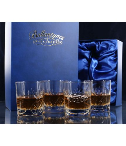 A panel cut whisky crystal hosting set consisting of four tumblers. We offer free engraving in the front panels of each item and the set is completed inside a dark blue satin lined presentation box.
