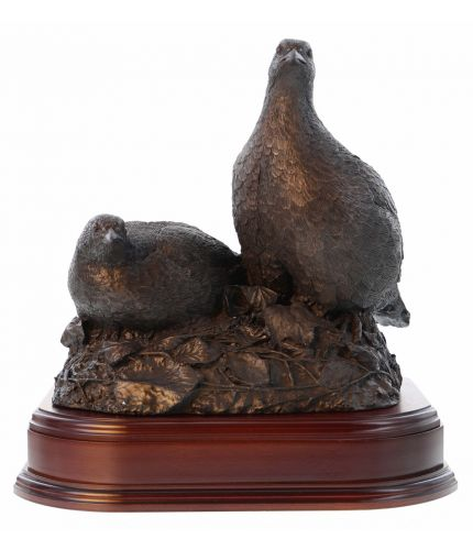 """A cold cast bronze sculpture of a breeding pair of Partridges sculpted at full scale (12"""" tall, 11"""" side to side and 9"""" front to back).  Fine detail and a lovely shooting award, presentation or ornament. We include the base and an engraved brass plate."""