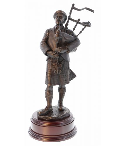"A Piobaireachd (Pibroch) Piper in cold cast bronze in a 12"" scale. This is the perfect gift for any serious piper or perhaps to a chieftain at a Scottish Highland Gathering. We offer the wooden base and the engraved brass plate as standard."