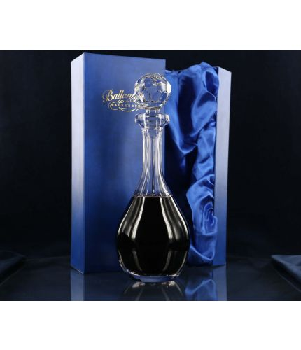 A panel cut wine decanter. We offer free engraving in the front panel of this item and the set is completed inside a dark blue satin lined presentation box.