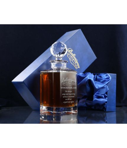 A plain cut crystal whisky decanter. We offer free engraving in the front panels of each item and it is completed inside a dark blue satin lined presentation box.