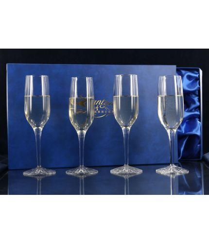 A set of four fully engraved Crystal Panel Style Champagne Flutes presented in a lovely satin lined dark blue gift box. An ideal gift to commemorate a very special occasion. We sort out the engraving with you once you place your order.  From agreeing the