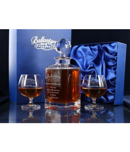 Brandy decanter and two goblet presentation set. This is the plain style and we include hand engraving as standard. The set is finished of in a dark blue satin lined presentation box.
