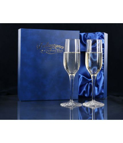 A Pair of Fully Engraved Crystal Champagne Flutes presented in a lovely satin lined dark blue gift box. An ideal gift to commemorate a very special occasion. We sort out the engraving with you once you place your order.  From agreeing the engraving draft
