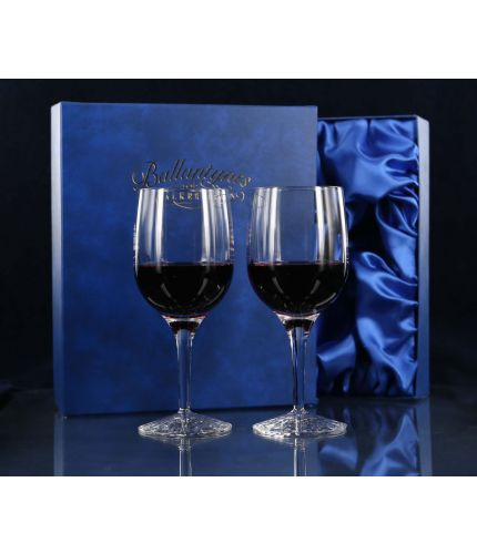 A pair of plain style cut white wine glasses. We offer free engraving in the front panels of each item and the set is completed inside a dark blue satin lined presentation box. From agreeing the engraving draft to delivery please allow 3 - 5 business days