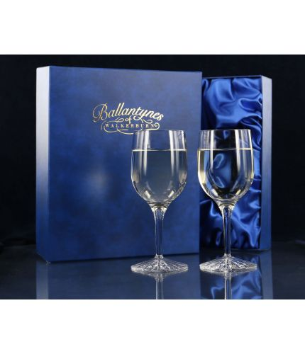 A pair of panel cut white wine glasses. We offer free engraving in the front panels of each item and the set is completed inside a dark blue satin lined presentation box.