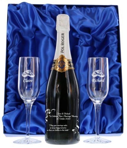 Pol Roger Champagne engraved gift set consists of a 75cl Bottle of Champagne and two plain crystal champagne flutes. It's beautifully presented in a lovely dark blue satin lined presentation box. Engraving is fully included.