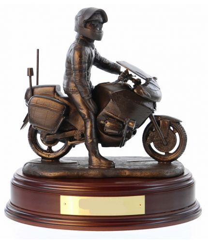 "A Police Officer on his BMW Motorcycle is sculpted in an 8"" scale and the figurine commemorates the officers serving in the Motorcycle Divisions of the British Police Service. We include the standard wooden base and an engraved brass plate as standard."